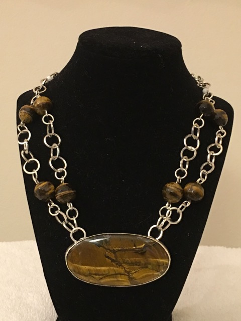 Handmade Silver chain links with genuine tiger eye gemstones, single strand chain link leads into a double strand securing the large oval tiger eye pendant